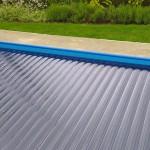Solar pool cover slats